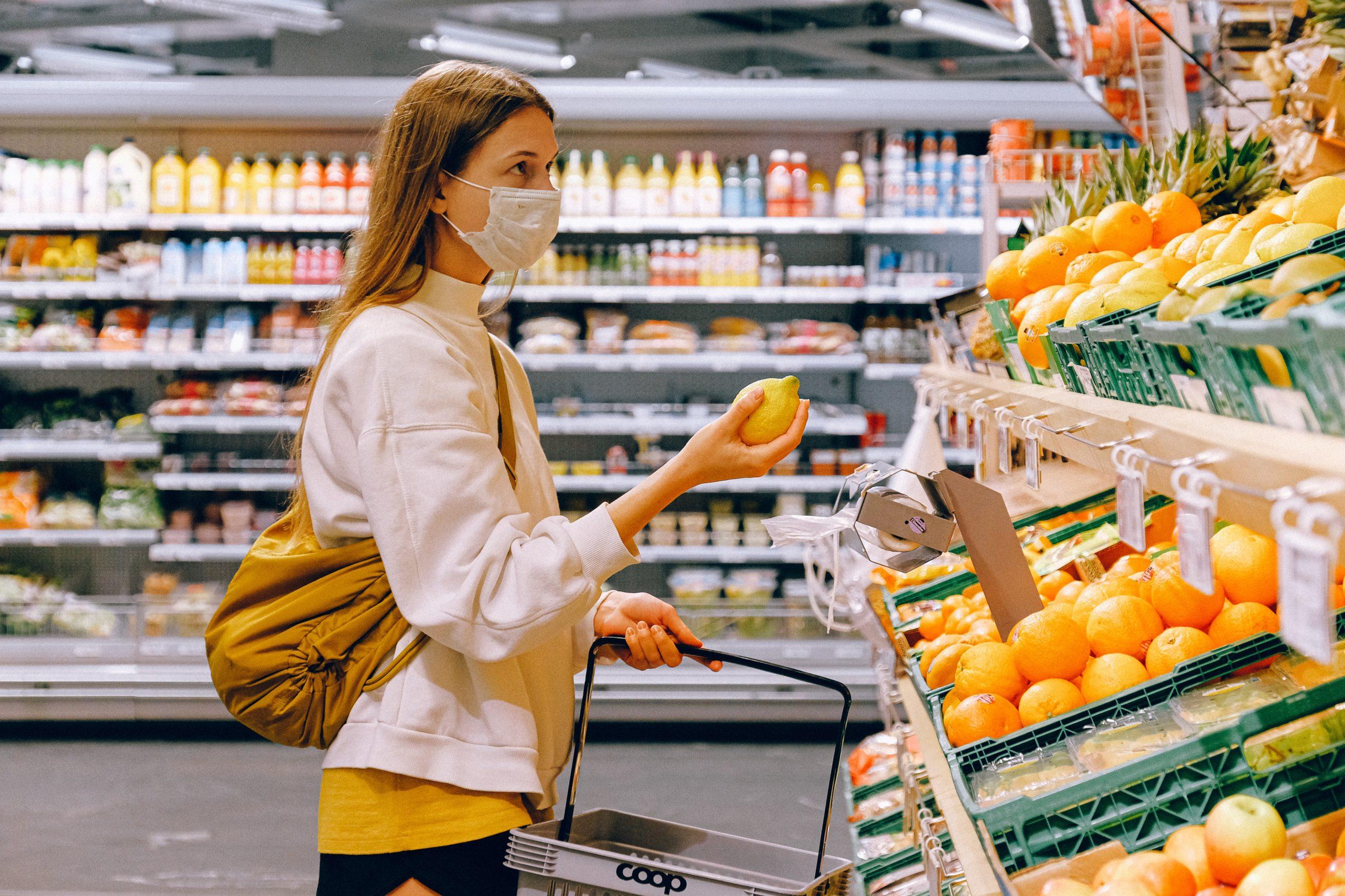 Lady in supermarket wearing mask