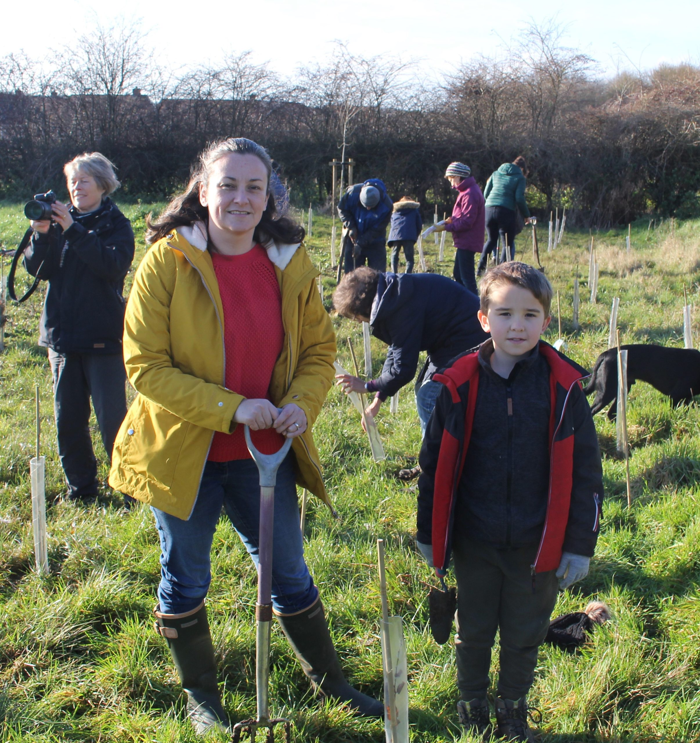Photo of Councillor Emily Smith leader of Vale District Council planting trees with her son