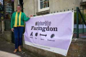 Cllr Bethia Thomas with new Covid-safety signage in Faringdon