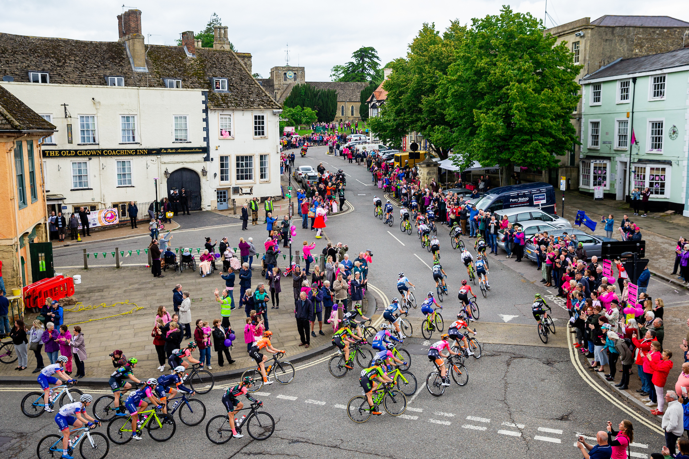 A group of cyclists cycle through Faringdon